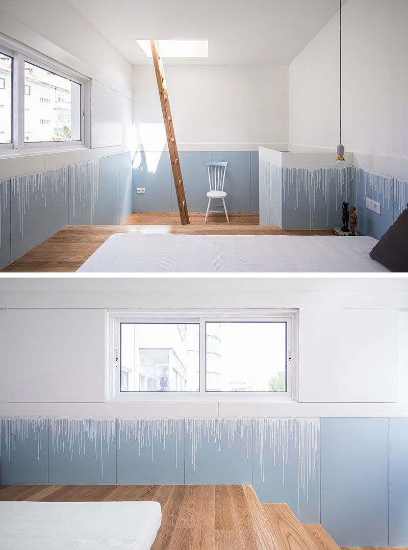 This modern bedroom has the lower half of the walls painted in the same blue as the kitchen and stairs, however a 'drip' effect has been used to transition between the white upper walls and the blue lower walls. #InteriorDesign #PaintColors #ModernBedroom