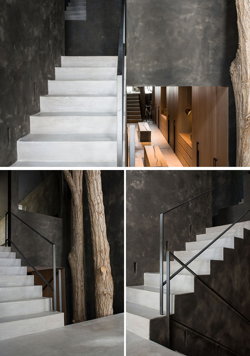 Light colored stairs by the front door of this modern home connect the multiple levels of the house, and contrast the dark walls. #Stairs #StairDesign