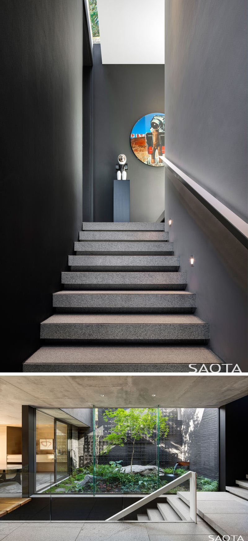A dark accent wall sits beside the stairs that leads down to the middle level of this modern house, that's home to a courtyard and garden, the bedrooms, bathrooms, a library and a lounge. #Stairs #Staircase #Courtyard