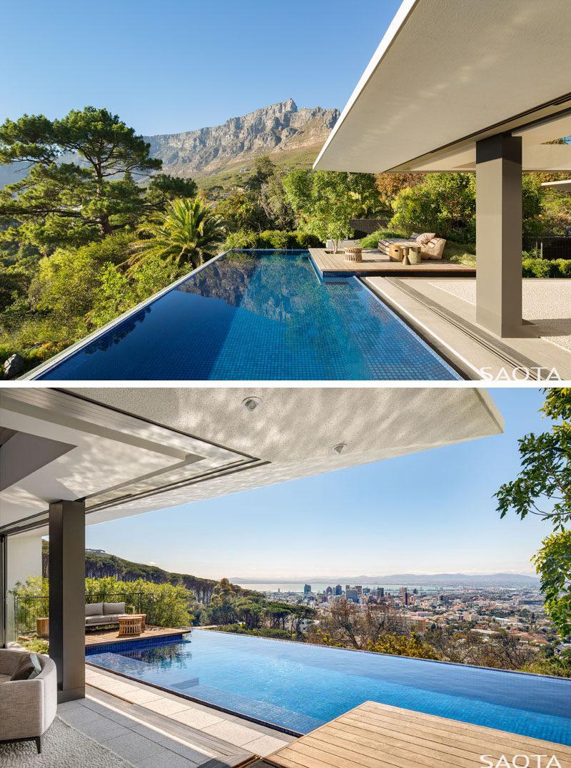 This modern swimming pool has two decks for enjoying the sunshine and the views. #SwimmingPool #Decks