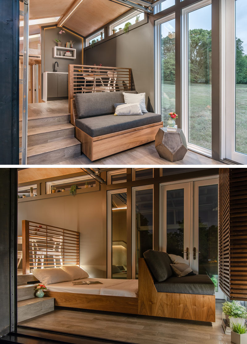 The small living room in this tiny home has a built-in couch that can be pulled out to reveal a full-size bed. #PullOutBed #TinyHome #TinyHouse