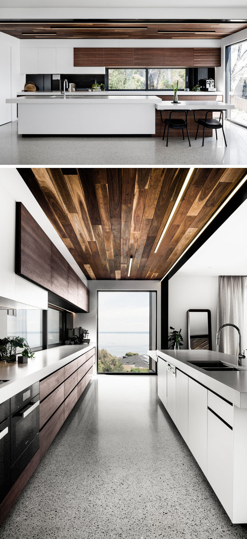 In this modern kitchen, the wood ceiling and wood cabinetry contrasts the bright white minimalist cabinets and kitchen island. A large window at the end of the kitchen has been positioned to take advantage of the sunset views. #KitchenDesign #ModernKitchen #WhiteAndWood