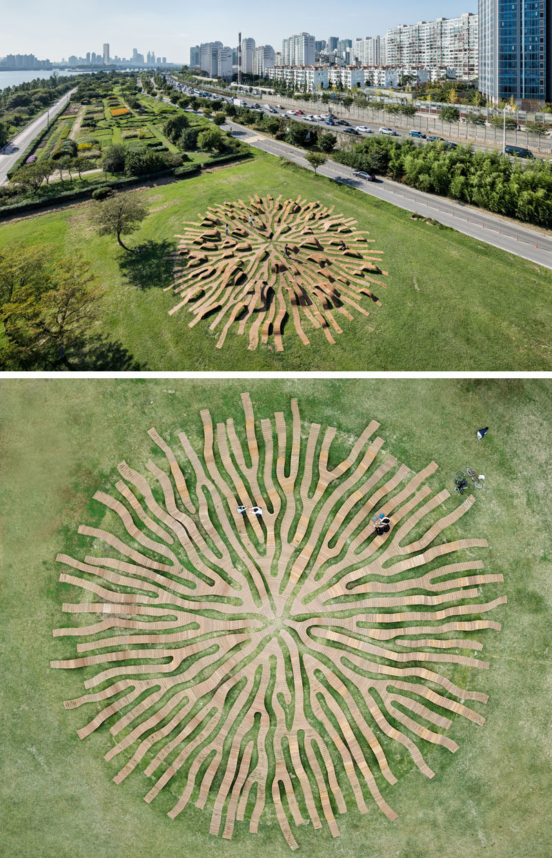 Yong Ju Lee Architecture have designed the Root Bench, a circle-shaped piece of public furniture that has a diameter of 30m, is installed in grass, and has the shape that's inspired by a root spreading throughout the park. #PublicFurniture #Art #Sculpture #Design