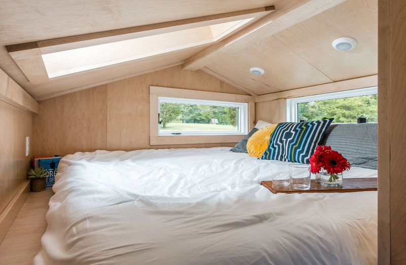 This modern tiny house has a lofted space with a king-size bed. #TinyHouse #Bedroom