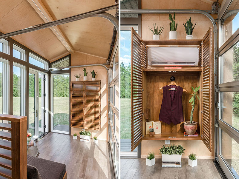 Inside this tiny house, the gabled ceiling gives the feeling of space, and beside the front door, a floating closet with wood slat doors hides the air conditioner and provides a place for hanging clothes. #Storage #Closet