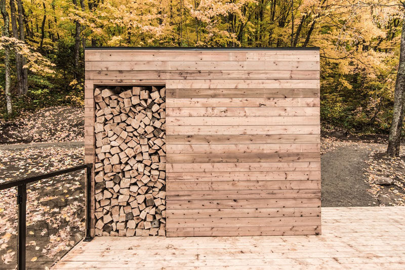 A small cabin has a separate firewood storage shed. #FirewoodStorage