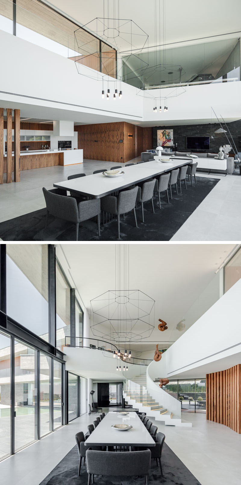 Central to the interior of this modern house is the main dining area, that takes advantage of the double-height ceiling, by having two minimalist geometric chandeliers hanging above a large dining table. #LargeDiningTable #DoubleHeightCeiling #InteriorDesign