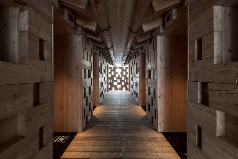 The wooden hallway of this hotel, that show off the woodwork used in building the huts, leads to the rooms. #Architecture #Wood