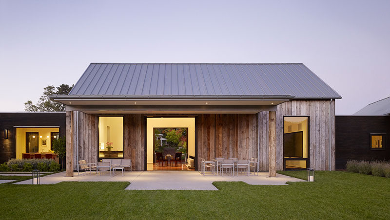 Walker Warner Architects have designed the Portola Valley Barn, a contemporary house in California, that features weathered wood siding and a tin roof. #Architecture #ModernHouse