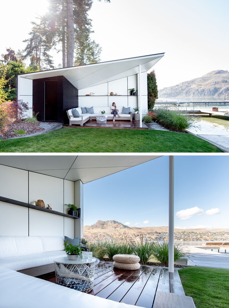 This modern lake house has a beach hut with an angled roof and a sitting area that's open to the elements. #BeachHut #OutdoorSpace #Architecture