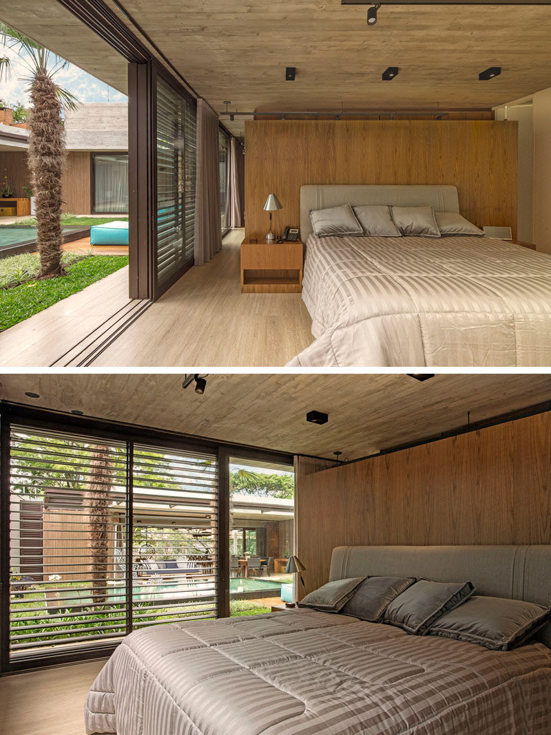 In this modern master bedroom, a wood accent wall adds a natural touch and a sense of warmth to the room. #Bedroom #ModernBedroom #BedroomDesign