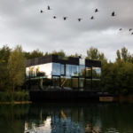 Floor To Ceiling Windows Line The Walls Of This Modern Lake House