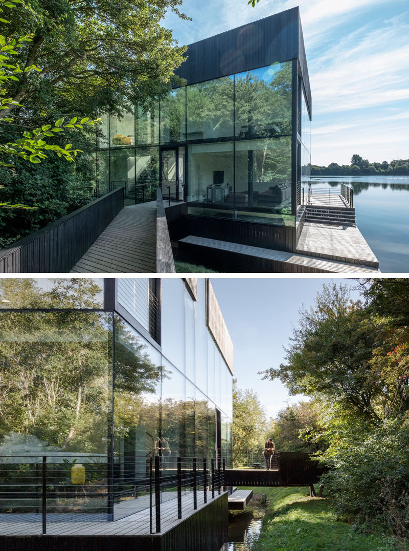 Mecanoo architecten have designed a modern house that sits on a lake in Lechlade, England, and features a walls of glass, enabling expansive views from the home's interior. #Architecture #HouseDesign #LakeHouse