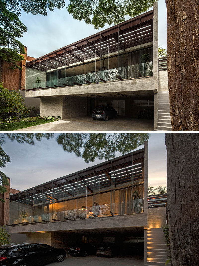 Pivoting glass panels proving a unique facade for this modern house, while lighting guides visitors to the front door. #ModernHouse #ExteriorLighting #Windows