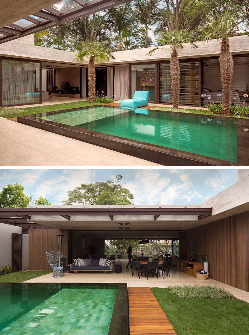 Upon entering this modern house, the courtyard is accessible from all of the different rooms, and outdoor seating areas provide additional space for entertaining. #ModernHouse #Courtyard #SwimmingPool