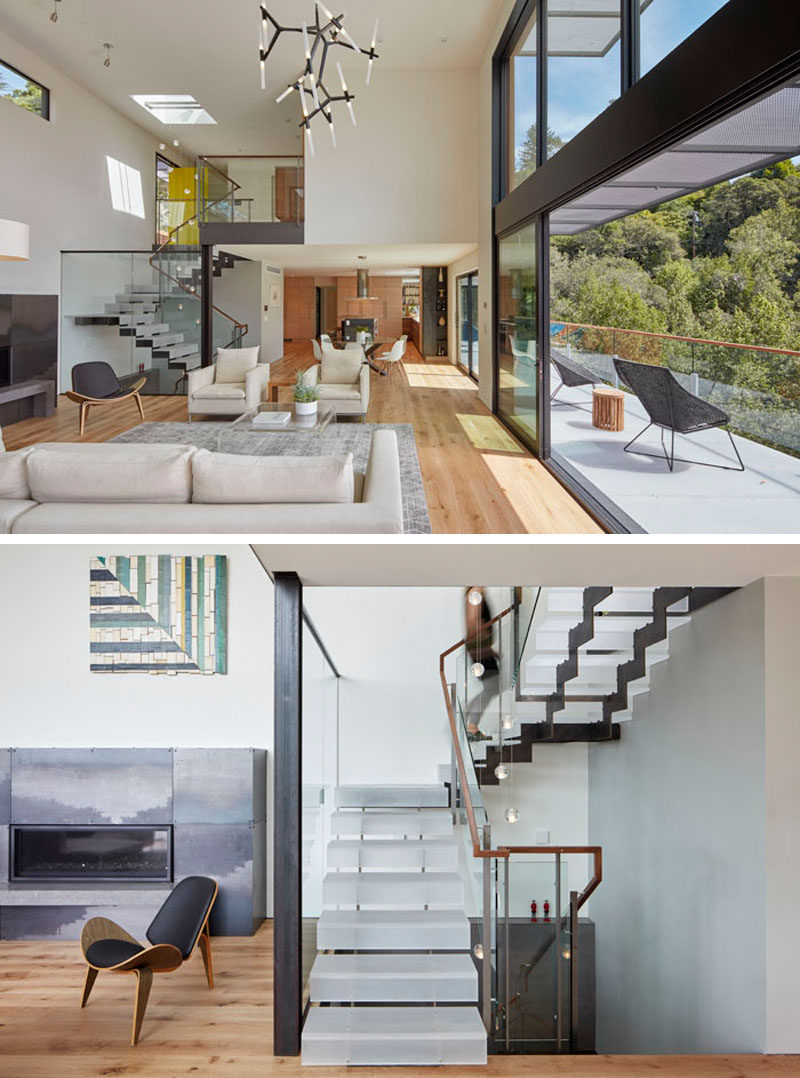 Stairs, made from laser cut steel plate stringers and clear acrylic treads with a sanded finish, lead from the foyer down to the social areas of this modern house. #Stairs #ModernStairs