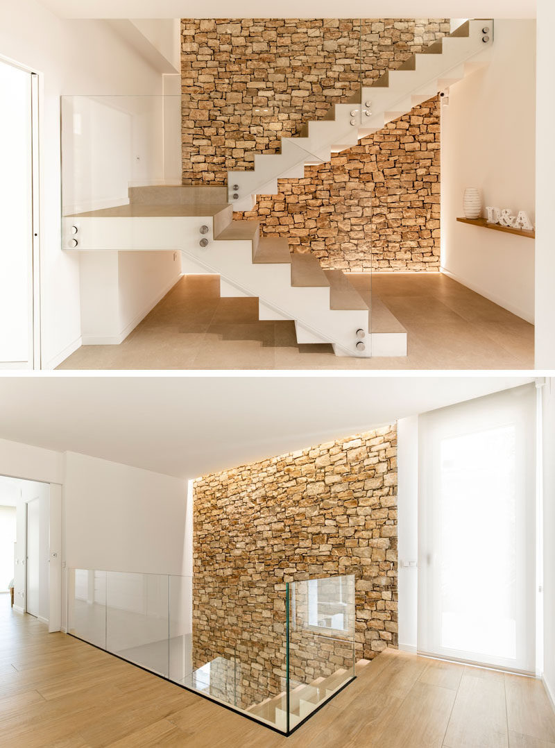 An accent stone wall has also been included inside this modern home, creating a natural backdrop for the staircase. #StoneWall #Stairs #Staircase