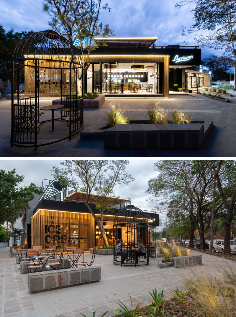 This modern cafe has an outdoor seating area that features two giant iron bird cages, that allow for a unique seating experience. #CafeDesign #Architecture