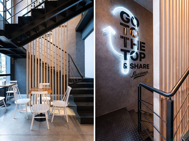 This modern cafe features Black steel stairs with a wood accent and neon lighting, that guide customers up to the rooftop. #Stairs #Cafe #NeonLighting