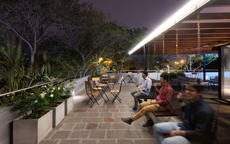 The rooftop of this ice cream cafe offers further seating, like swings, tables and chairs, and couches, with a view of the neighborhood. #RooftopSeating #Restuarant