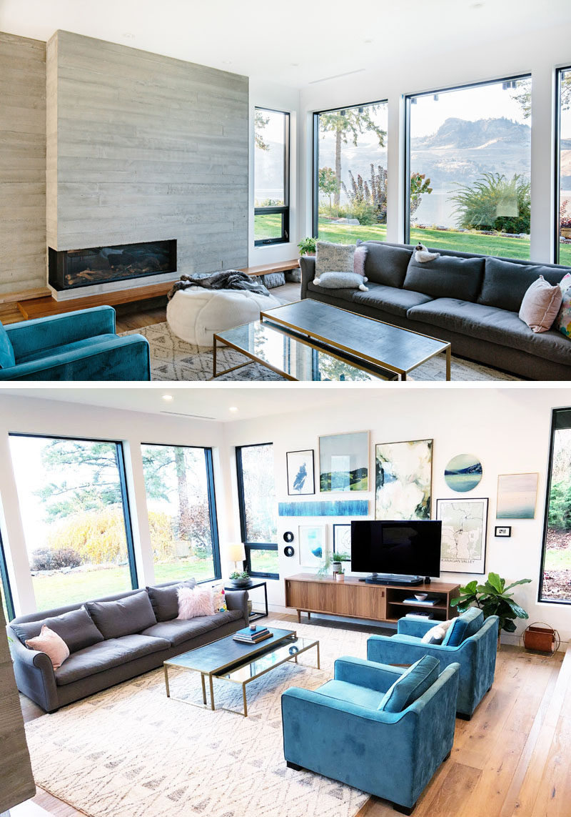 In this modern living room, large windows look out towards the lake, while a fireplace keeps it cozy in the winter. #LivingRoom #Fireplace #Windows