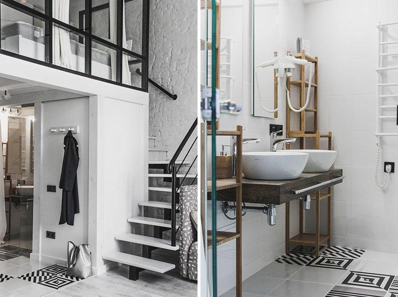 This modern loft apartment has a small bathroom tucked away underneath the mezzanine bedroom. #Bathroom #DualSinks