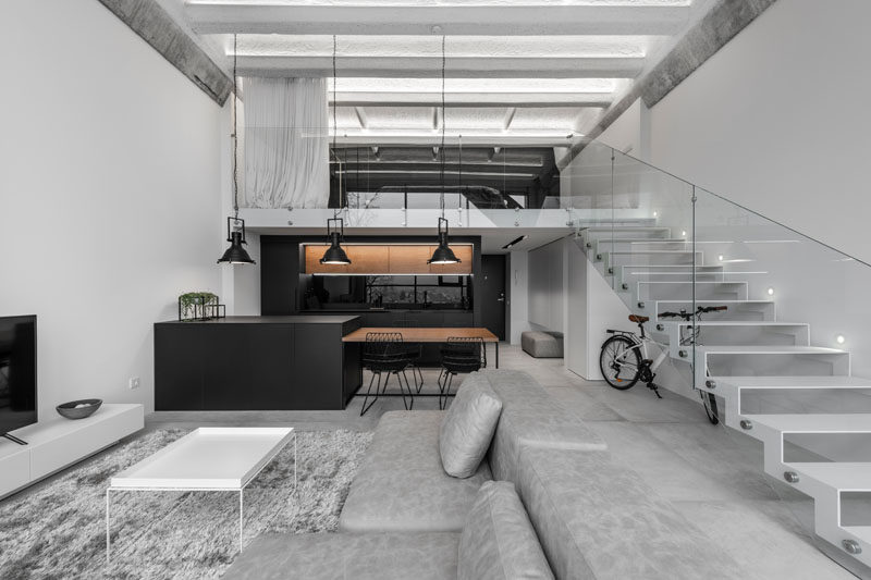 Design firm IDwhite has recently completed the interiors of a modern industrial loft in Kaunas, Lithuania. #ModernLoft #IndustrialLoft #InteriorDesign