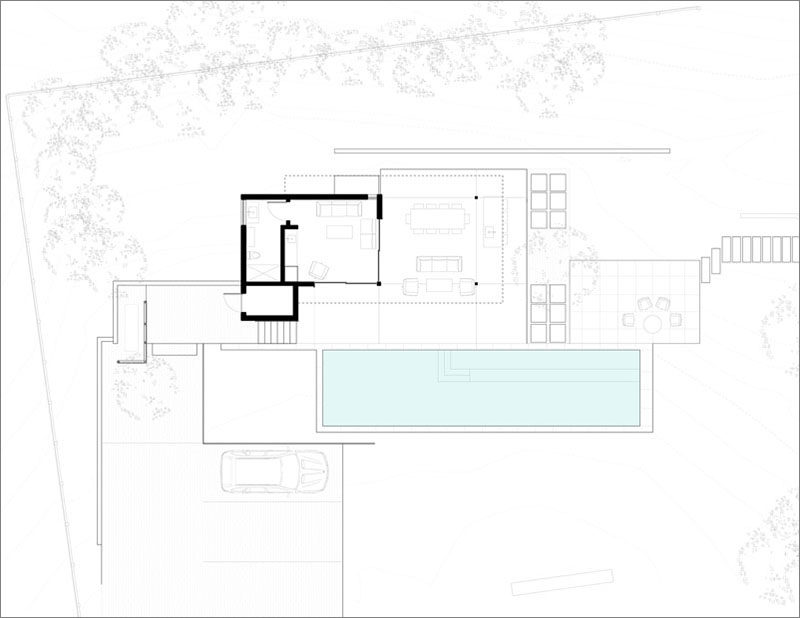 The floor plan of a modern pool house and terrace, that sit beside a swimming pool, bocce court, garden, and guest parking. #FloorPlan #PoolHouse