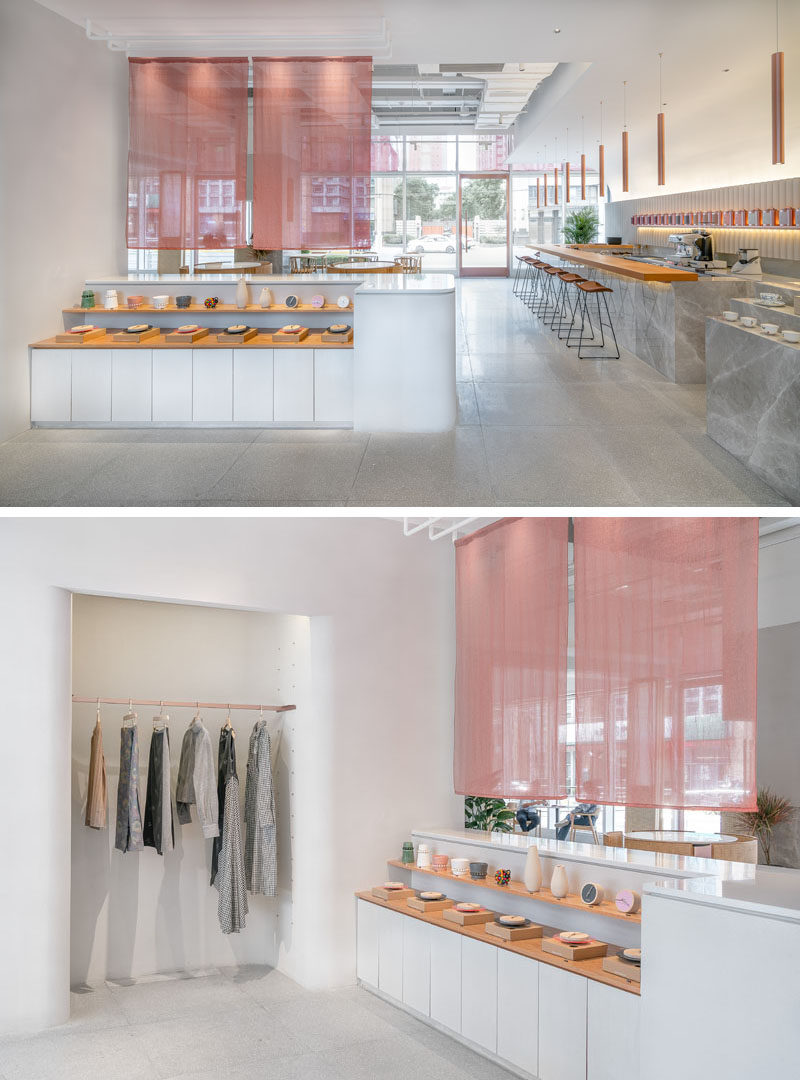 Inside this modern tea house, there's a small display area and an alcove for hanging coats, while sheer pink curtains create a divide between the lobby and the seating area. #Retail #StoreDisplay #RestaurantDesign #InteriorDesign #TeaHouse