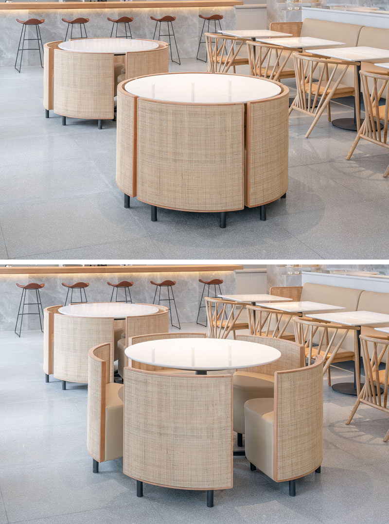 This custom designed table and chairs set, inspired by the shape of a cake, creates seating for diners, however the chairs can be tucked away under the table when there's a party, and the set can then be used as a display table. #Furniture #RestaurantDesign