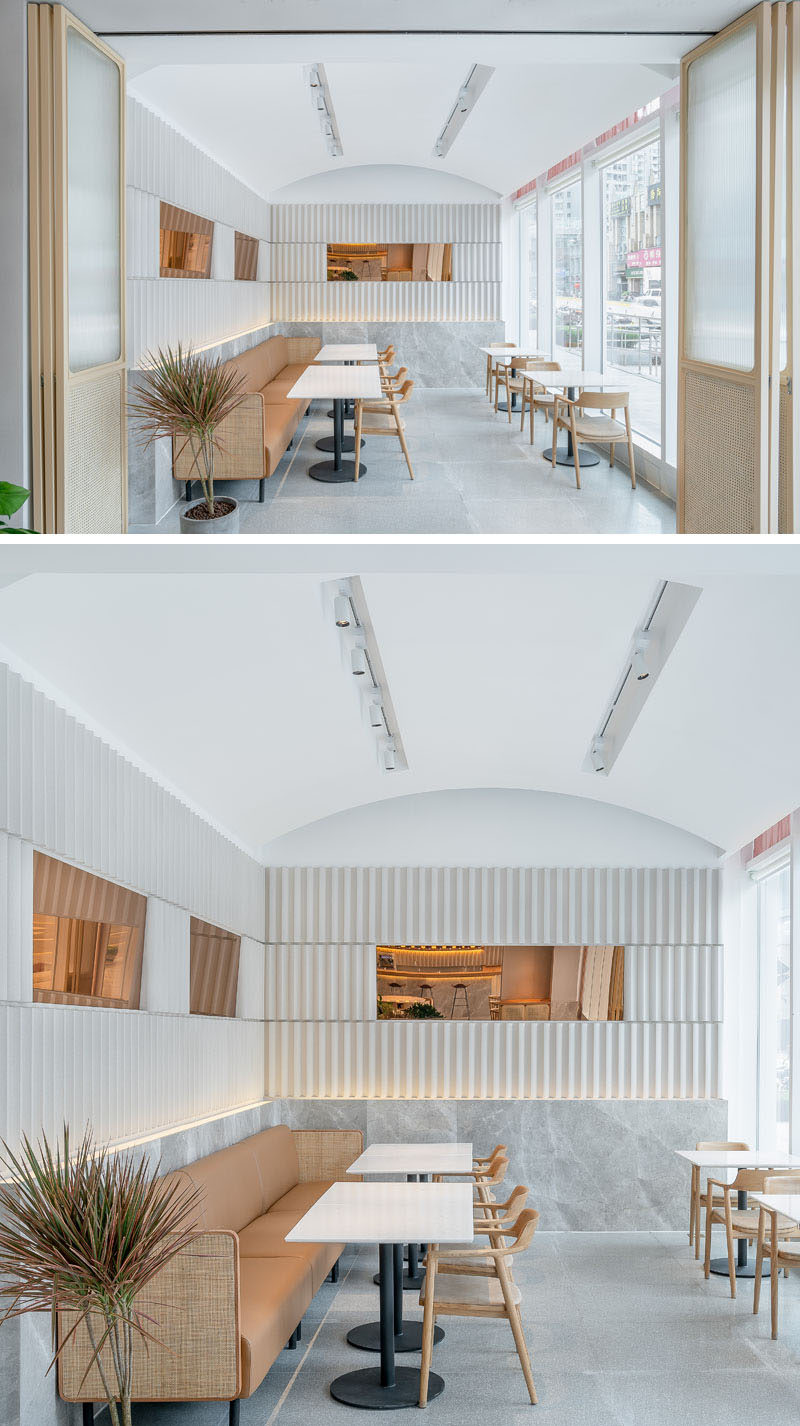 This modern tea house has a lounge room with a curved vaulted ceiling, and a long couch that runs the length of the wall. The doors can be closed when required for meetings and small events. #CafeDesign #RestaurantDesign #InteriorDesign