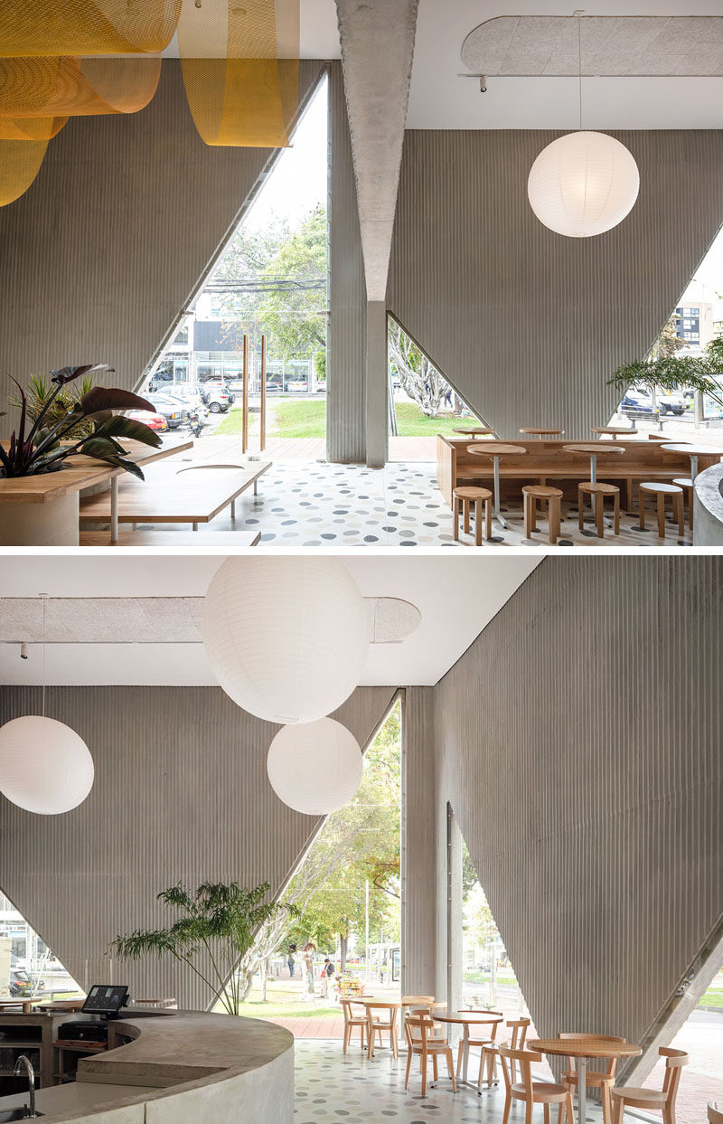 Triangular cutouts open the facade of this restaurant to better connect at sidewalk level while revealing a glimpse of the interior. #Restaurant #Cafe #Windows