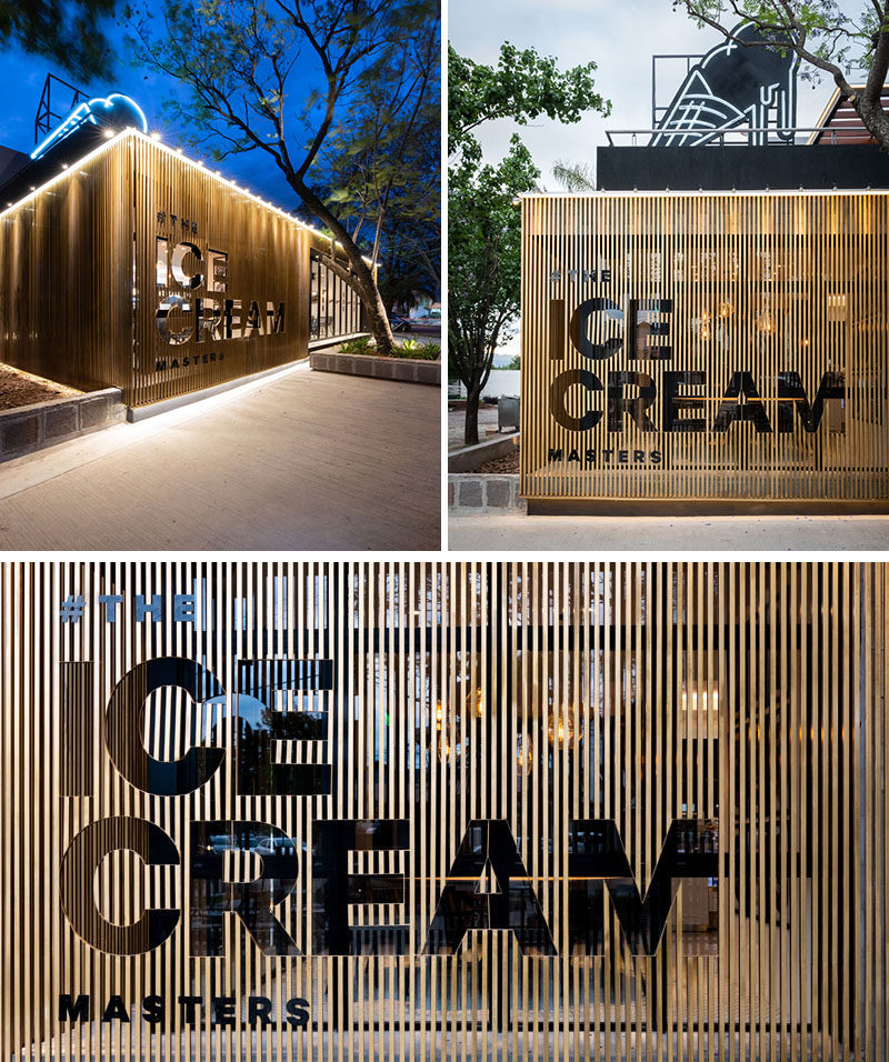Materials used throughout this modern cafe include concrete, stone, wood, ceramic, marble, and iron. The sign on the exterior of the cafe has been 'cut-out' from the wood slat siding. #Signage #CafeDesign