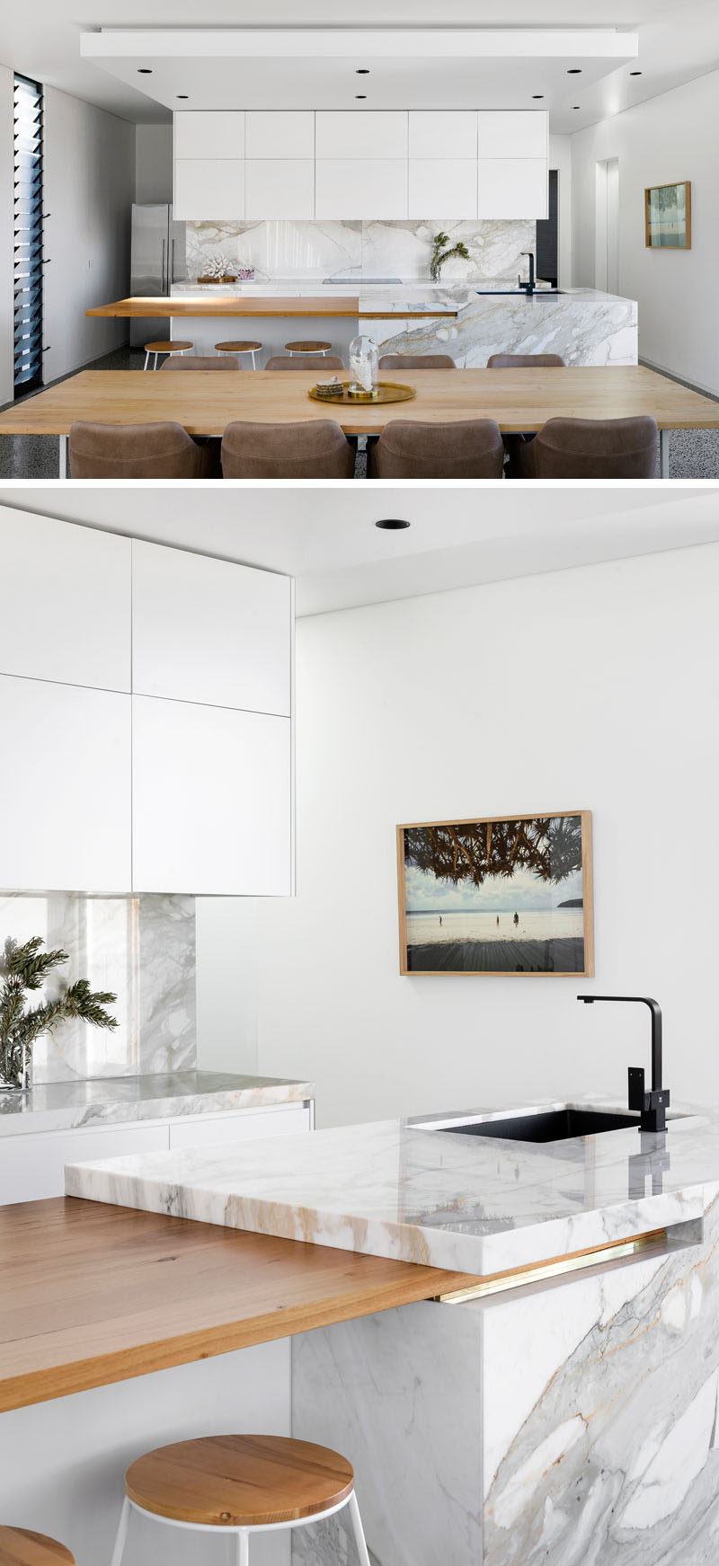 In this kitchen, white cabinetry is combined with stone and a wood countertop for a modern look. #ModernKitchen #KitchenDesign