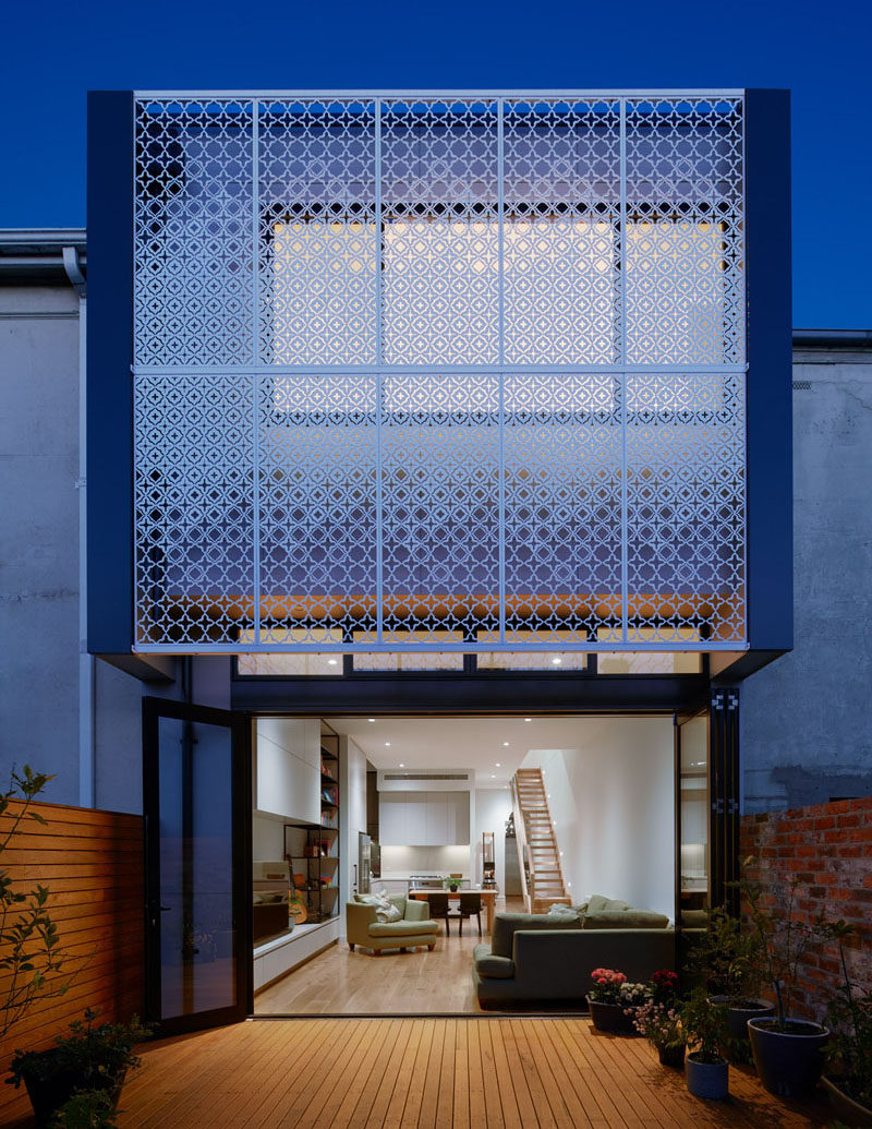 Chan Architecture have added a custom-designed metal screen to this house, providing a decorative accent and privacy to the interior of the home. #Facade #Screen #Architecture