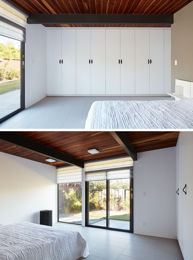 In this simple bedroom, a wall of cabinetry provides plenty of storage, while a window and sliding glass door provides natural light and access to the garden. #Bedroom #Closets #Windows