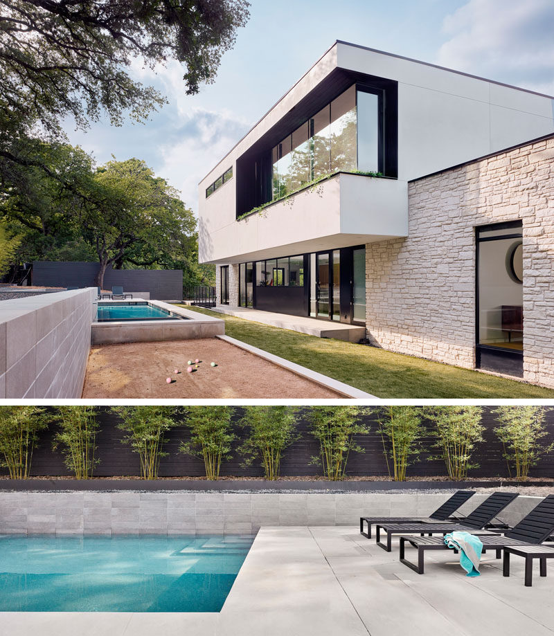 The backyard of this modern house has a variety of levels with a bocce court and a swimming pool. #ModernHouse #Backyard #SwimmingPool #BocceCourt #Landscaping