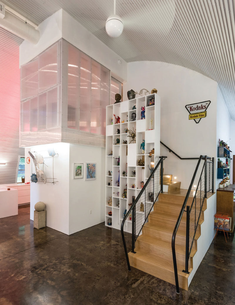 The stairs, the loft and the shutter polycarbonate windows allow visitors to experience the tallness of this modern house.. #Stairs #InteriorDesign #Shelving