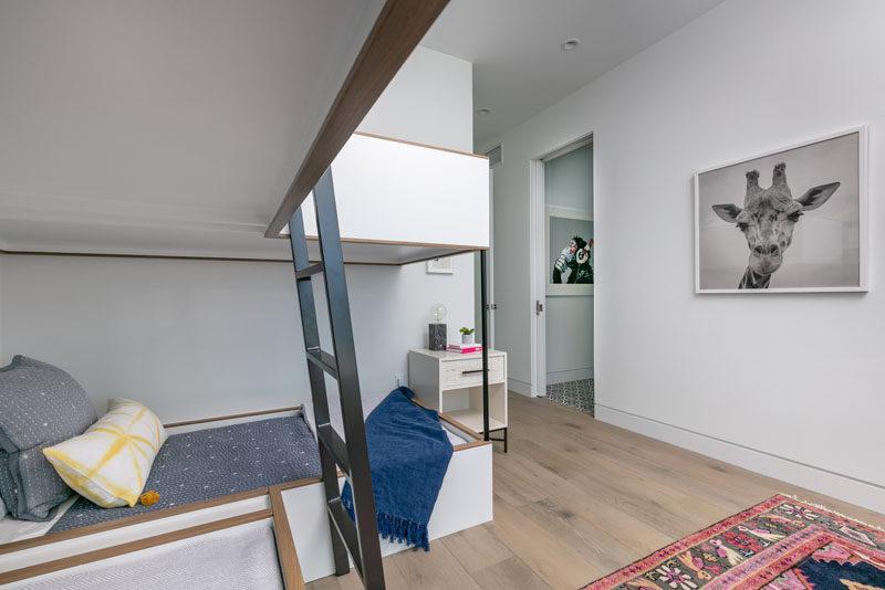 In this modern bedroom, minimalist bunk beds line one of the corners. #Bedroom #BunkBeds