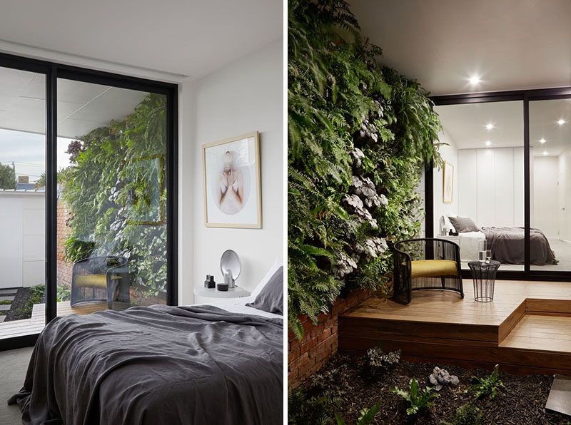 This modern bedroom has access to a small covered wood deck with a green wall that looks out onto the garden.  ModernBedroom #Garden #Greenwall #Deck
