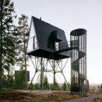 A Series Of Elevated Cabins Were Built On A Farm In Norway