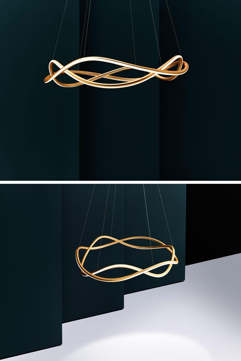 London-based lighting studio Luum, have designed their latest chandelier named Aurora, that features a formed aluminum body and Japanese 3D tube-bending technology. #ModernChandelier #ModernLighting