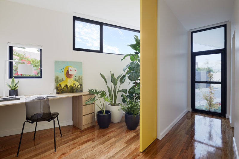 This modern house has a home office that's tucked away into a small angled space. #HomeOffice
