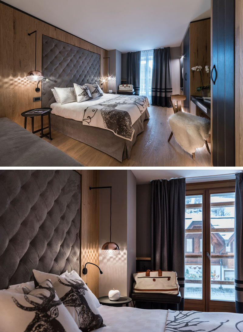 This modern hotel room features upholstered headboards that are built into the wood walls. #Bedroom #Headboard #InteriorDesign