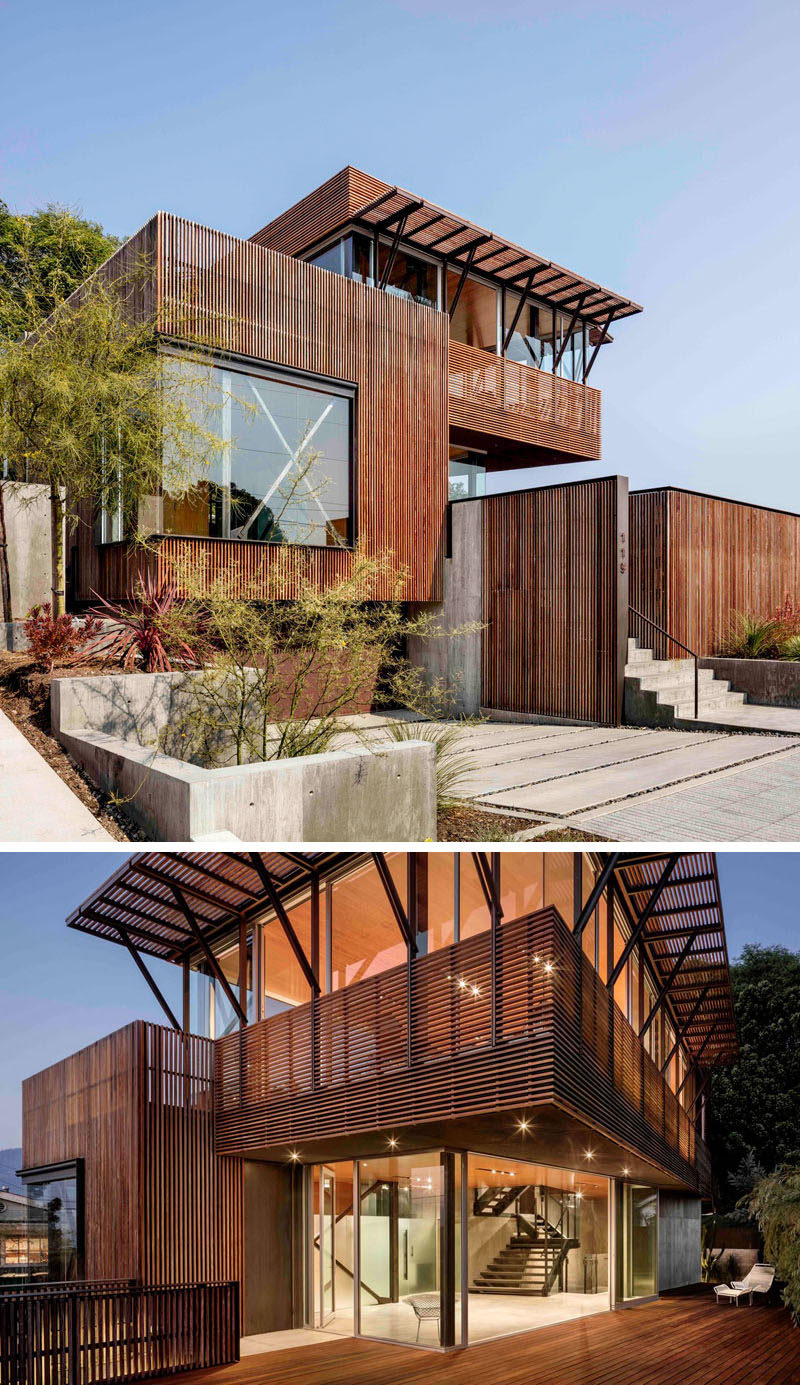 Ipe wood screens cover the exterior of a modern house.