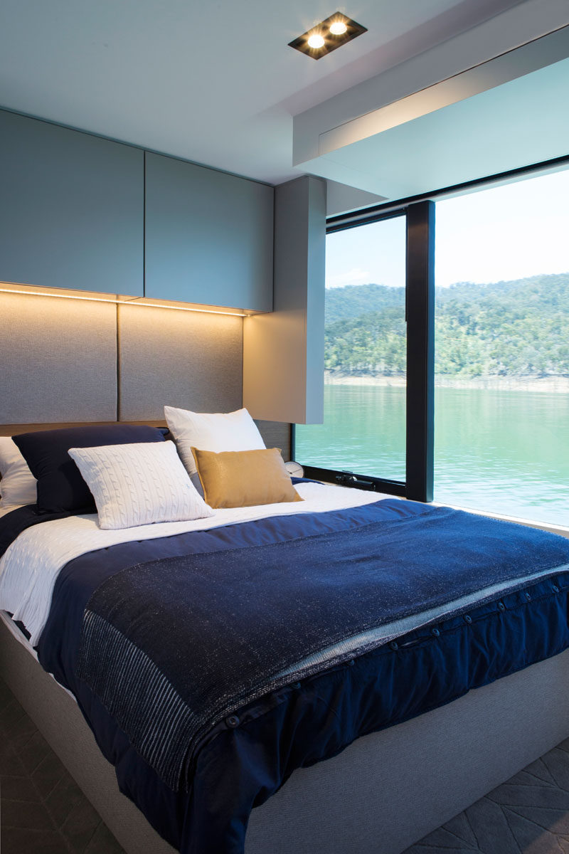 This modern houseboat has beds that elevate to reveal hidden storage underneath. #Bedroom #Houseboat
