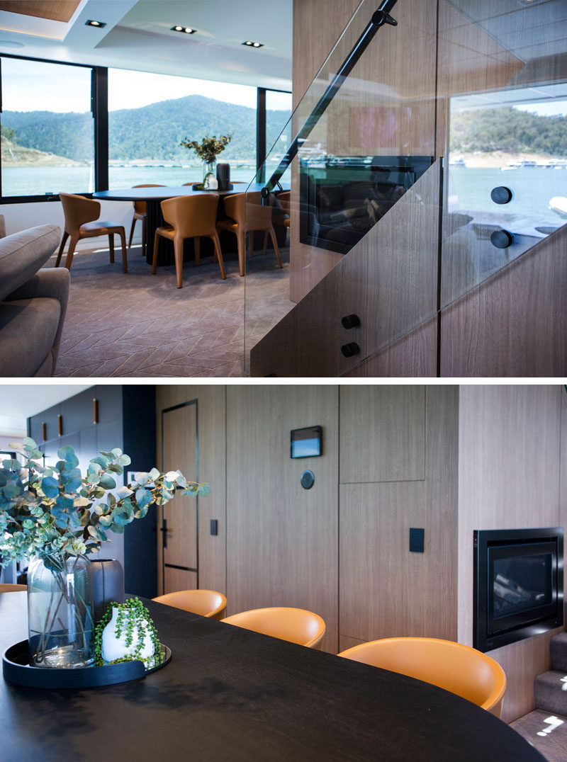 The dining room on this modern houseboat features a dark wood oval table large enough to seat 8 people. #DiningRoom #Houseboat