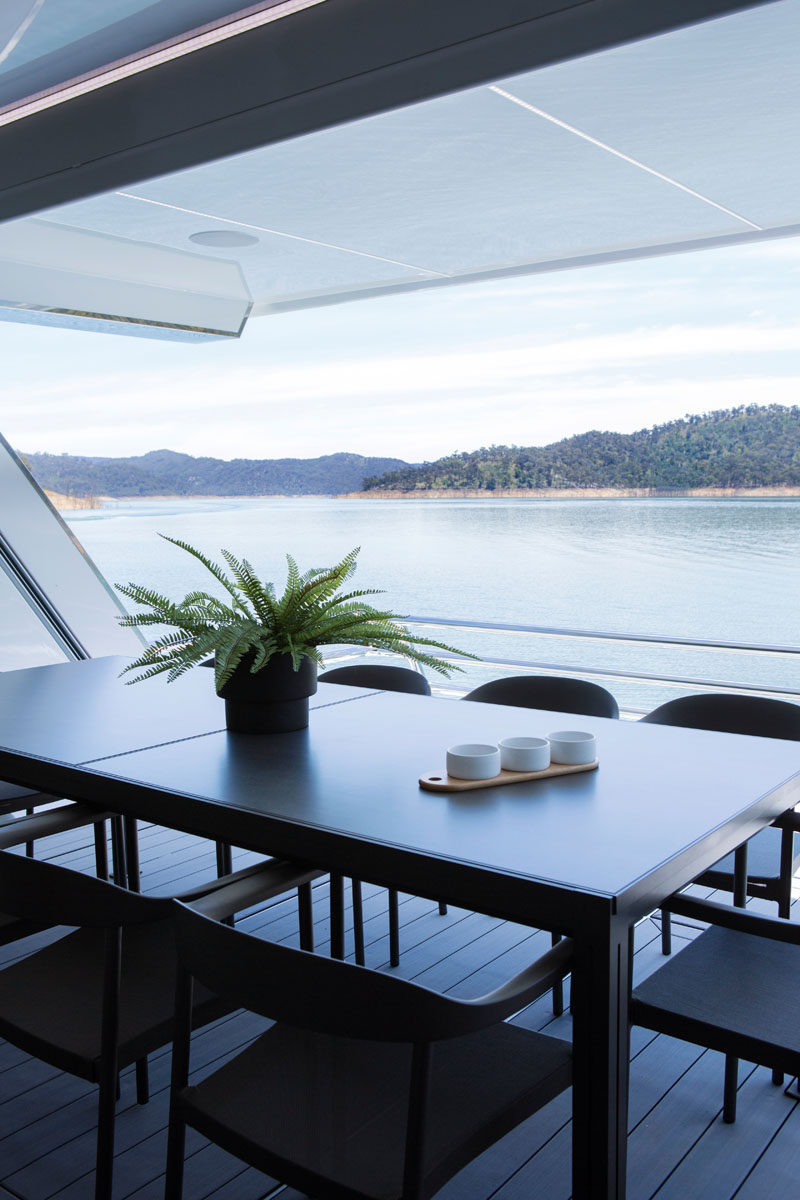 This modern houseboat has a covered alfresco dining area. #AlfrescoDining #HouseBoat