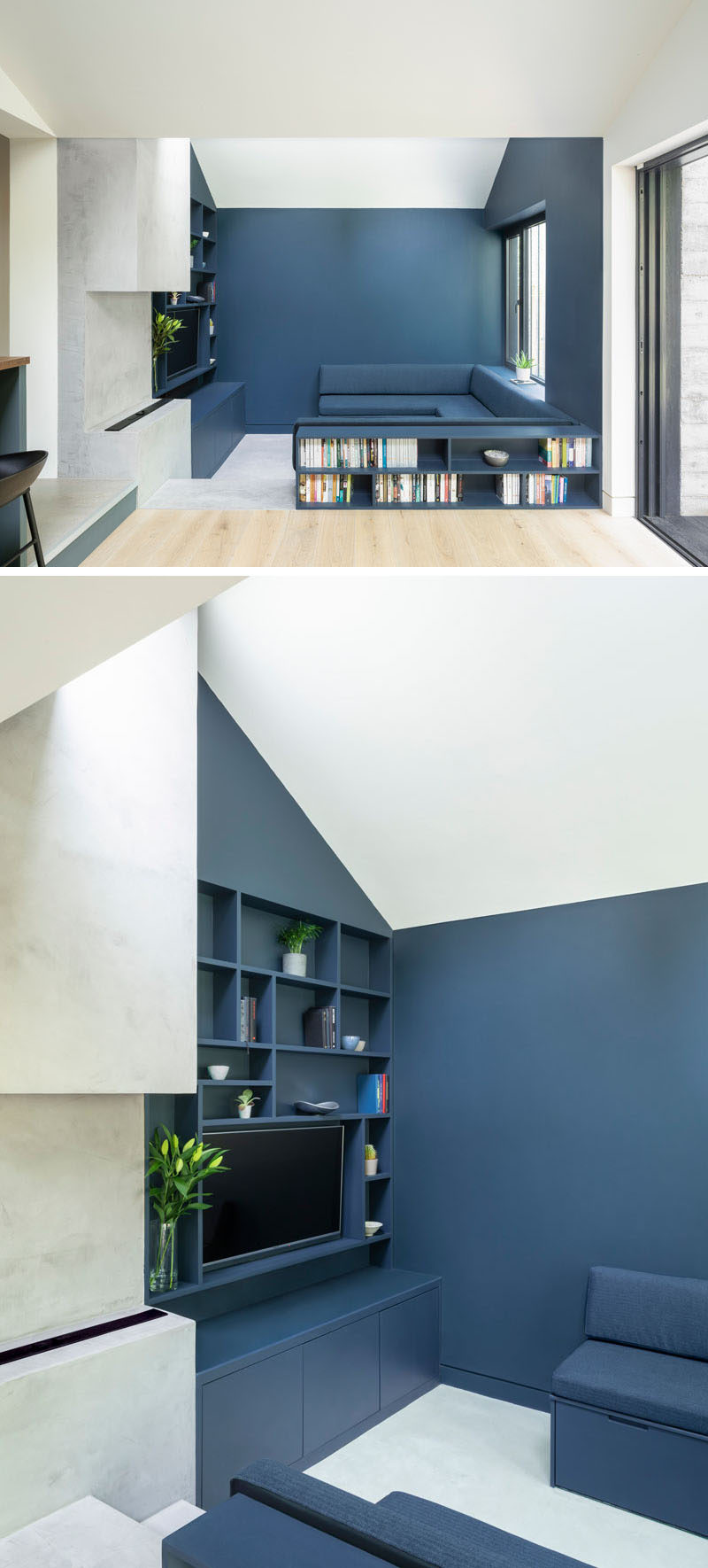 Inside this contemporary house extension, the living room is defined bydeep-blue, that's been used for the walls, bookshelves, and the wrap-around U-shaped couch. #LivingRoom #ModernLivingRoom