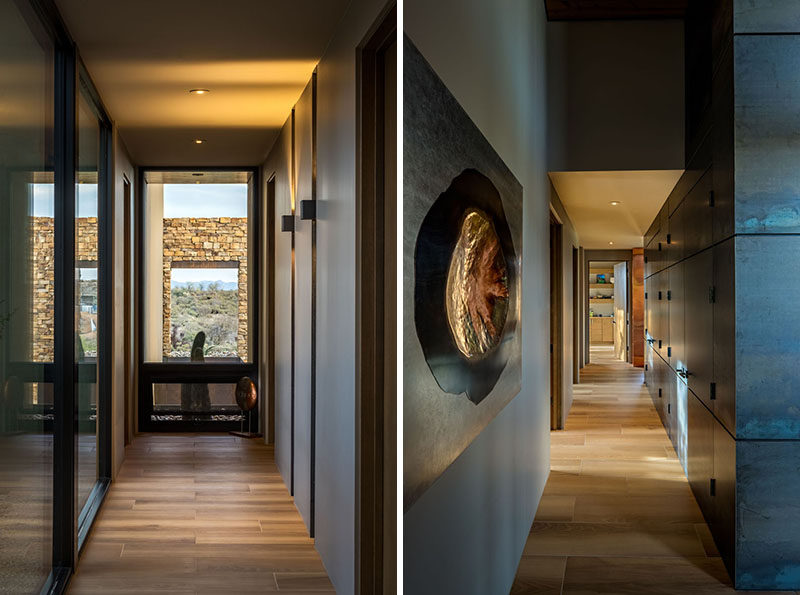 Connecting the various areas throughout this modern house are hallways that use lighting and shadows to create interest. #ModernHallways #InteriorDesign